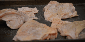 raw, seasoned chicken thighs