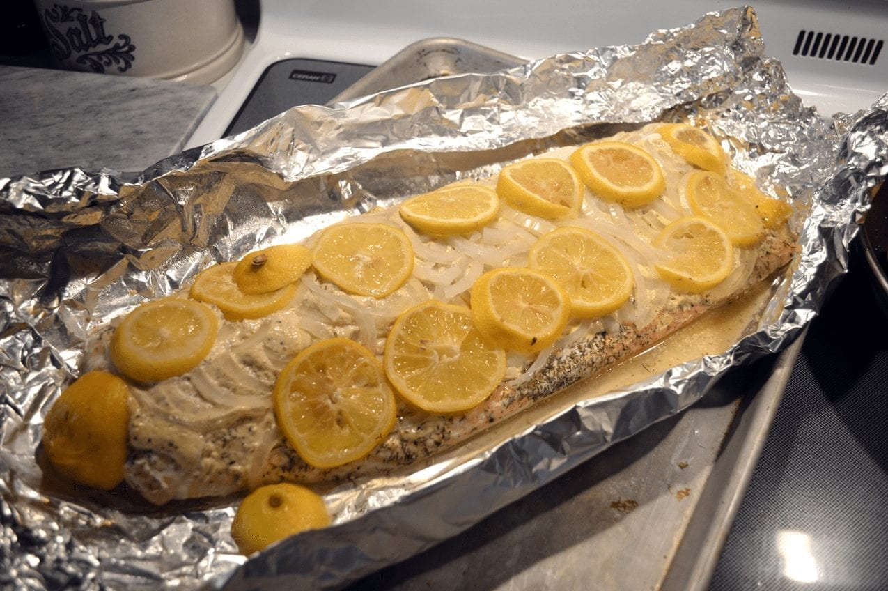 Salmon Filet Baked with Onions, Lemons